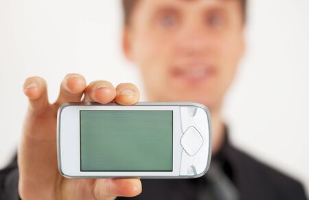 Man shows LCD screen of white mobile phone photo