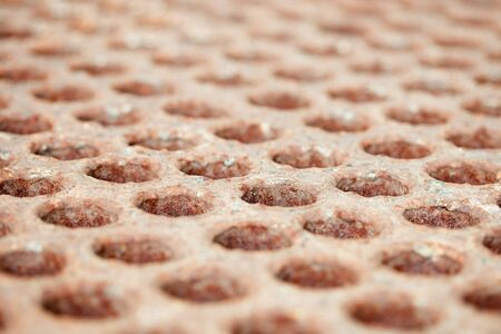 Rusty surface with holes - a close up Stock Photo - 7511834