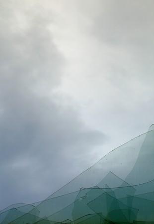 The cloudy sky through the broken window photo