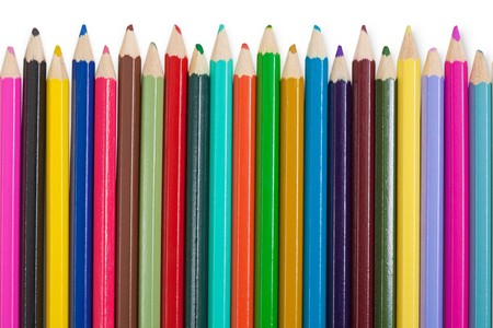 Set of childrens color pencils on a white background photo
