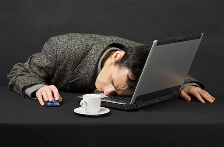 sleeping at desk: The guy worked at night in the Internet, was tired and has fallen asleep