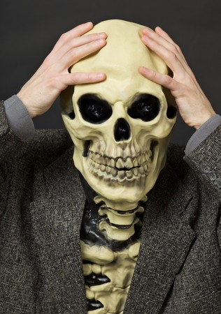 completely: The amusing scared person in a mask - a skull Stock Photo