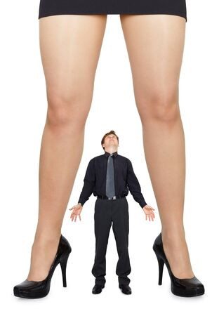 diminutive: Female legs and little amazed man on white background Stock Photo