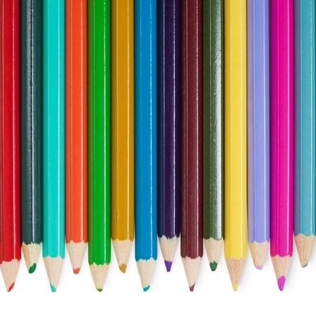 Fourteen childrens color pencils on a white background photo