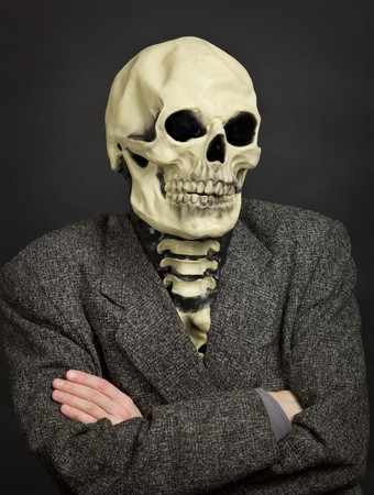 Portrait of the person in a skeleton mask against a dark background photo