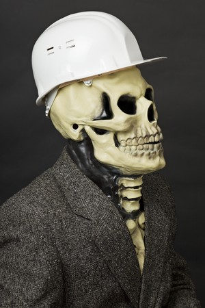 The deadly construction superintendent in a white protective helmet photo
