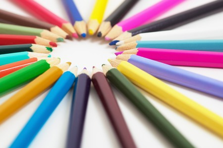 Set of childrens wooden color pencils on a light background photo