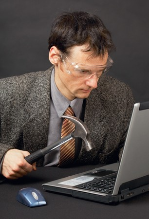 The person repairs the laptop as is able photo