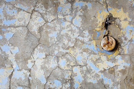 mustiness: Background - an old wall in the thrown house with electroconducting fragments Stock Photo