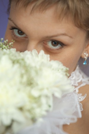 marriageable: Portrait of a bride with a bouquet - eyes closeup