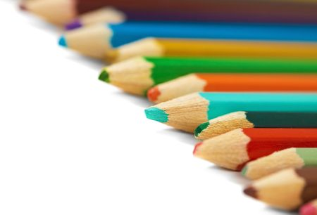 Several different colored pencils on a white background photo