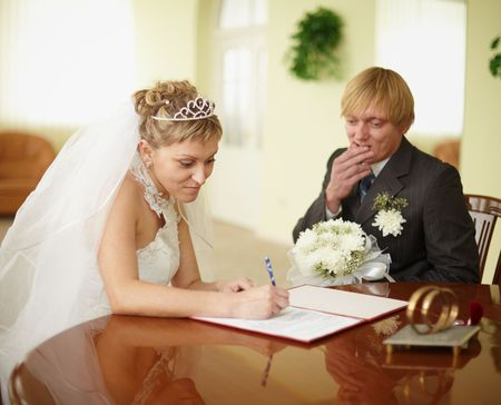 The official registration of marriage. Groom in doubt.