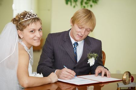 The official registration of marriage. Happy newlyweds.