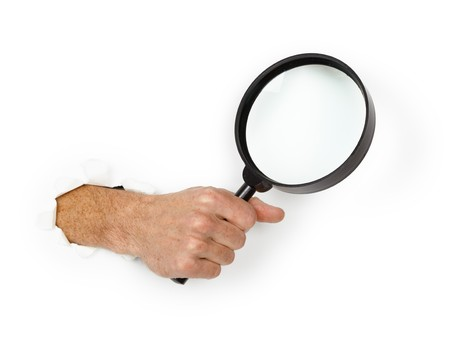 Male hand holding a magnifying glass on a white background photo