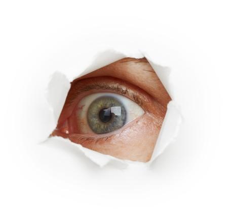 ノゾキ - 穴を通して目スパイ。白の背景 写真素材 - 7799008