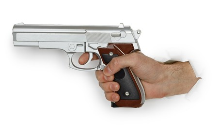 Hand armed with a pistol on a white background photo