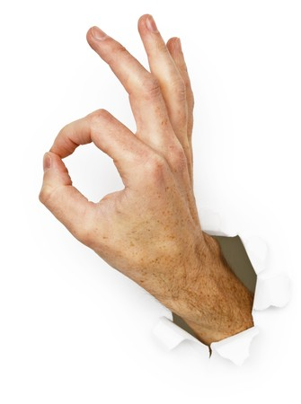 The hand with a gesture - Ok isolated on a white background photo