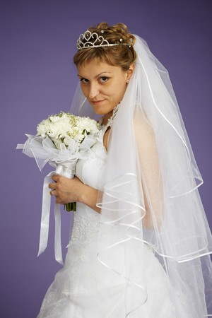 marriageable: Portrait of a bride with a bouquet of flowers Stock Photo