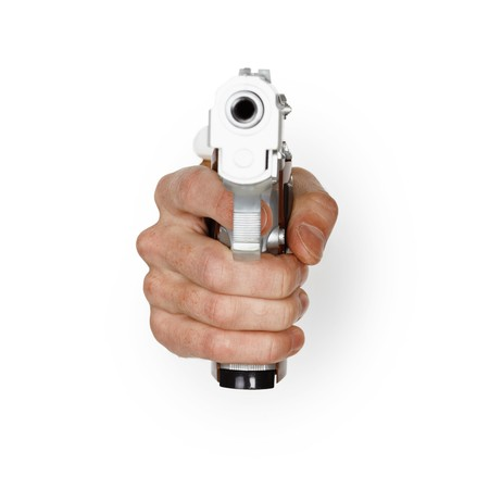 Hand aiming a pistol on a white background photo
