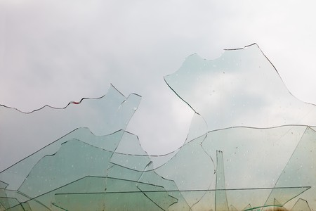 View from the window through the old broken glass photo