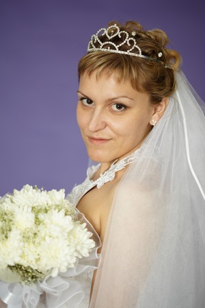 Portrait of a bride with a bouquet of white flowers photo