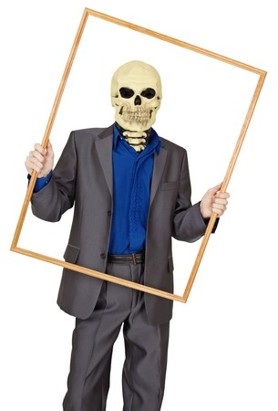 A man dressed as a skeleton in a wooden frame on white background Stock Photo - 7799092