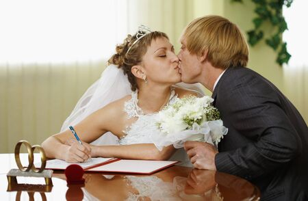 The bride and groom kiss during the ceremony of marriage Stock Photo - 7799097