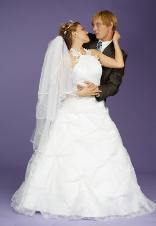 necking: The bride and groom pose on studio