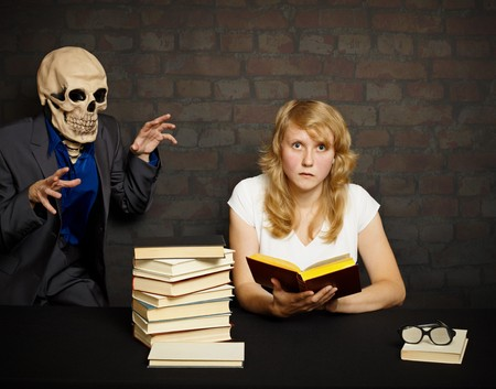A woman reads a scary books in the dark photo