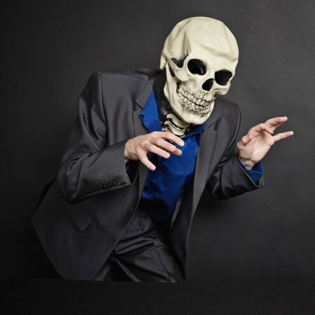 The terrifying person in a skeleton mask is stolen on dark background Stock Photo - 7966645