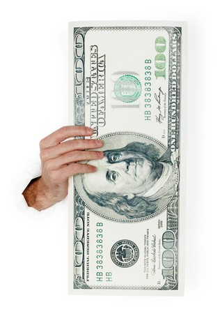 The hand holds huge paper dollar isolated on white background photo
