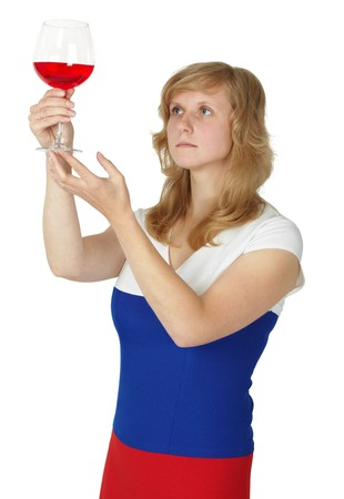 opacity: The woman - a taster checks the color and opacity of wine