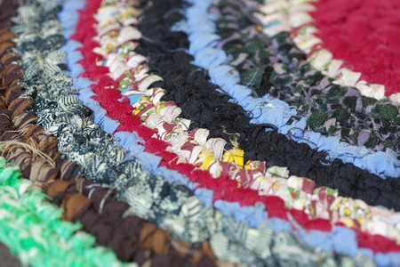 The vintage homemade colorful mat close up photo