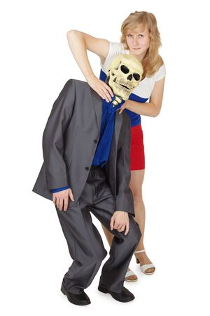 Girl choking a man in a mask of death isolated on a white background photo