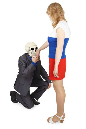 The skeleton kisses a hand to the young woman Stock Photo - 8028436