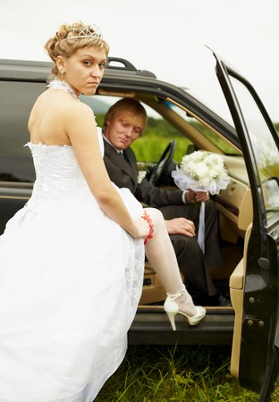 The sexual bride and the groom in the car photo