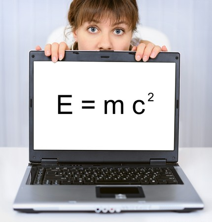 formulation: Young woman shows us a computer screen with formula Stock Photo