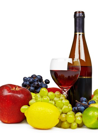 spirituous beverages: Still life with a bottle of wine, fruit and a glass isolated on white background Stock Photo