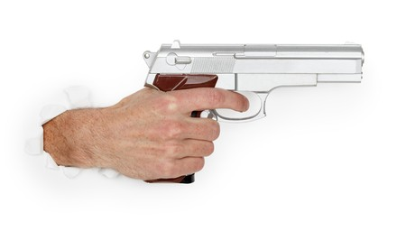 Mans hand holding a large silver handgun isolated on white background photo