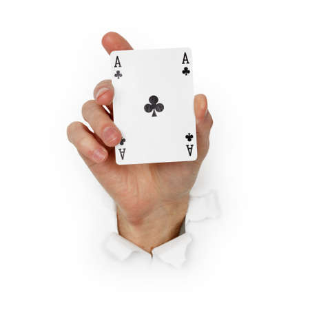 Hand holds the ace of clubs isolated on a white background photo