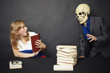 Night reading of terrible books leads to nightmares Stock Photo - 8204654