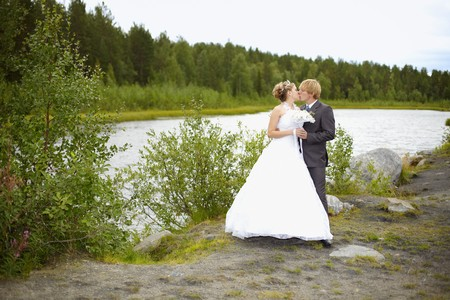 The bride and groom on the nature of the pond
