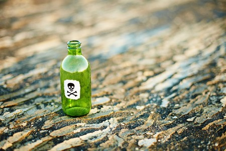 scoria: Green glass bottle from a poison on the ground