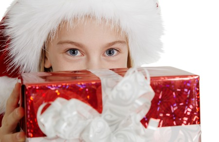 Teen girl in a Christmas hat with a gift of a close-up photo