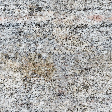 Seamless texture - a surface of a rough gray granite photo