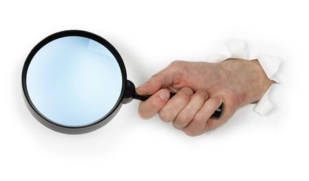 A large magnifying glass in hand isolated on white background photo