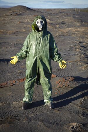 A man in a chemical protective suit stands in the desert Stock Photo - 8271764