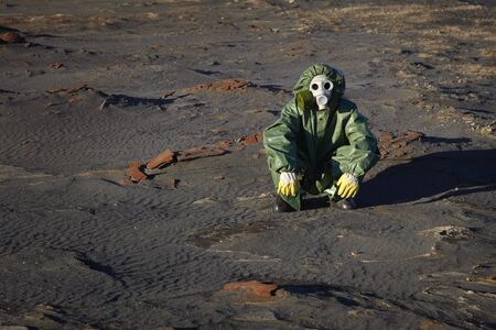 A man in protective clothing sitting in the desert Stock Photo - 8271787