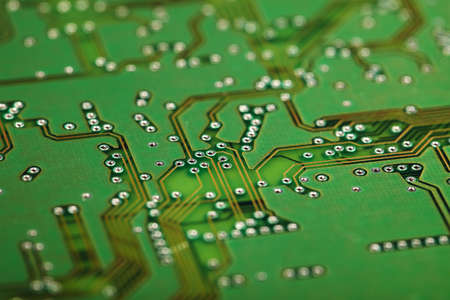 microscopical: Circuit board close up - a green industrial background