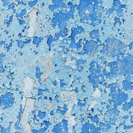 Damaged paint on a concrete wall - a seamless background photo